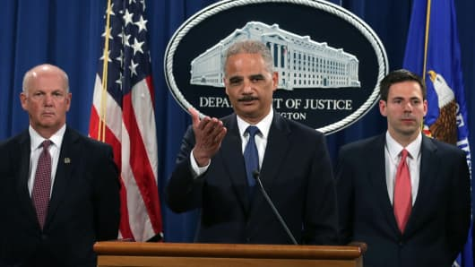 Attorney General Eric Holder (2nd L), U.S. Attorney for Western District of Pennsylvania David Hickton (L), and Assistant Attorney General for National Security John Carlin (R) take questions from members of the media during an announcement on indictments against Chinese military hackers on cyber-espionage May 19, 2014 at the Department of Justice in Washington, DC.