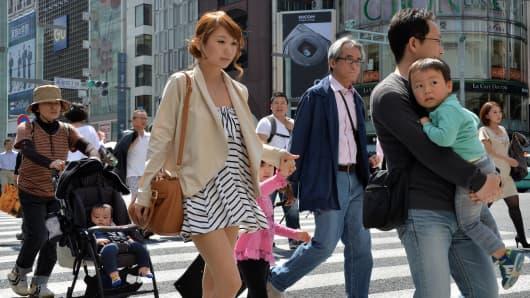Pedestrians walk in Tokyo's Ginza shopping district.