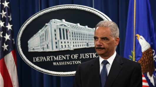 U.S. Attorney General Eric Holder listens during a news conference to announce indictments against Chinese military hackers on cyber-espionage.
