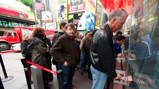 Visitors stand in line to purchase tickets to Broadway Shows in Times Square.