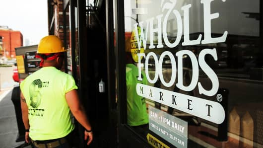 A man walks into Whole Foods Market in Brooklyn, New York, on May 7, 2014.