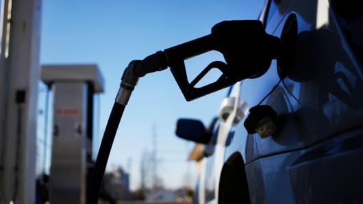 A gasoline pump nozzle refuels a sport utility vehicle in Bagdad, Kentucky, Feb. 26, 2014.
