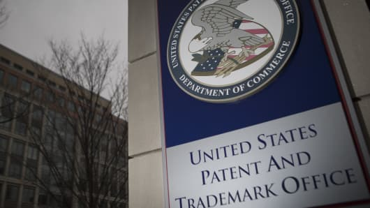 The U.S. Patent and Trademark Office (USPTO) seal is displayed outside the headquarters in Alexandria, Virginia