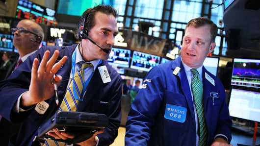 Trader on the floor of the New York Stock Exchange, May 21, 2014.
