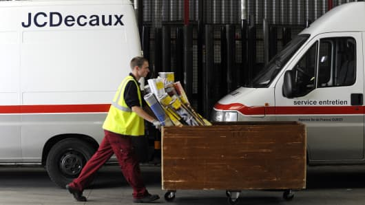 A JCDecaux employee transports advertising posters at the company's depot in Gennevilliers, France