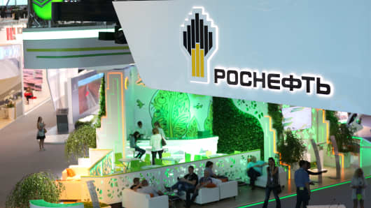 Visitors sit in the OAO Rosneft stand in the sponsor's hall at the St. Petersburg International Economic Forum (SPIEF)