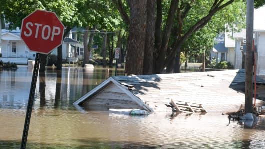A garage that floated down a street is still submerged in floodwater June 16, 2008 in Cedar Rapids, Iowa.