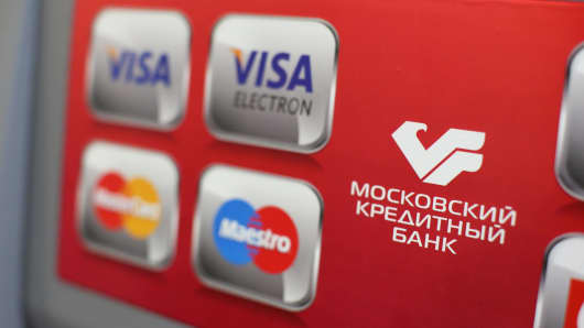 Visa and Mastercard payment systems on an automated teller machine inside a Credit Bank of Moscow branch in Moscow, Russia, April 22, 2014.