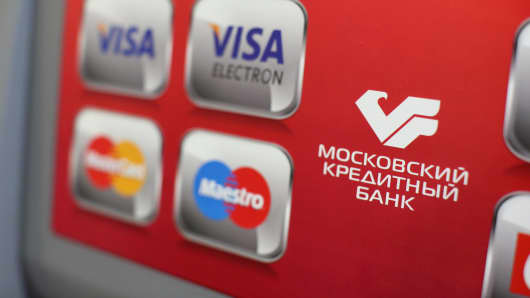 Logos for Visa and Mastercard on an automated teller machine at a Credit Bank of Moscow bank branch in Moscow.