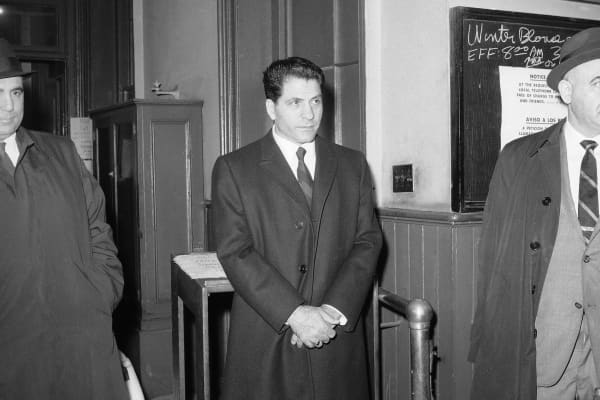 """John """"Sonny"""" Franzese is booked at the Elizabeth St. police station in New York, March 24, 1966, after his arrest on a 43-count gambling indictment."""