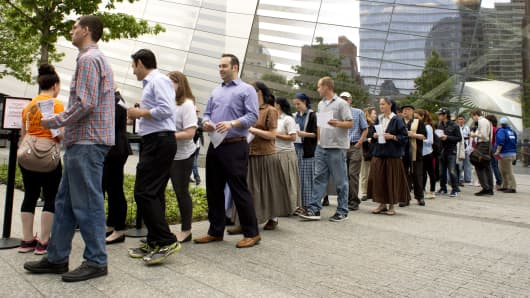 People line up to enter the 9/11 Memorial Museum on May 21, 2014 in New York.