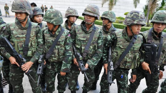 Thai army soldiers at the venue for peace talks between pro- and anti-government groups on May 22 in Bangkok following the announcement of a coup.