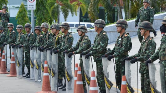 Thai army soldiers secure the grounds of the venue for peace talks between pro- and anti-government groups on Thursday in Bangkok, a few hours before the army chief announced armed forces were seizing power.