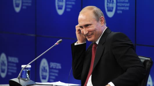 Russia's President Vladimir Putin attends an economic forum in Saint Petersburg, on May 23, 2014.