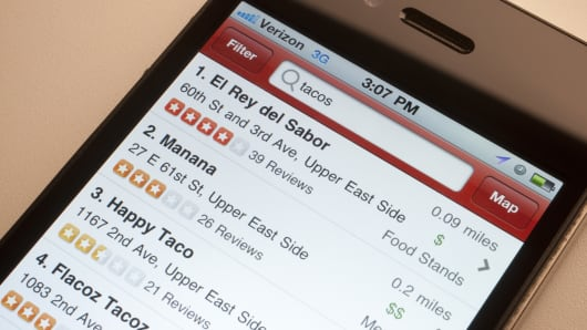 Restaurant reviews displayed on the Yelp app.