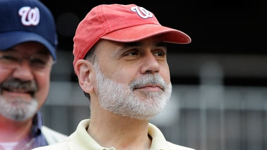 Former Chairman of the Federal Reserve Ben Bernanke watches the game between the Washington Nationals and the Toronto Blue Jays at Nationals Park.