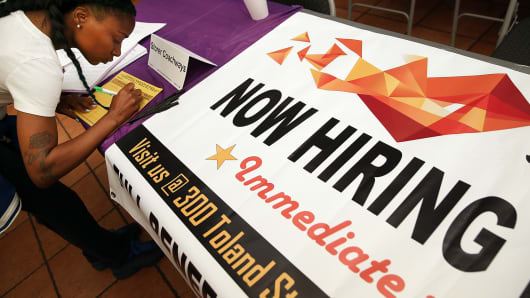 A job seeker fills out an application during a career fair at the Southeast Community Facility Commission on May 21, 2014 in San Francisco.