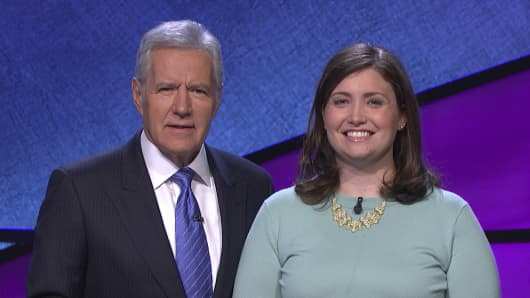 "Alex Trebek, left, host of the TV show ""Jeopardy!,"" poses with contestant Julia Collins, 31, of Kenilworth, Ill."