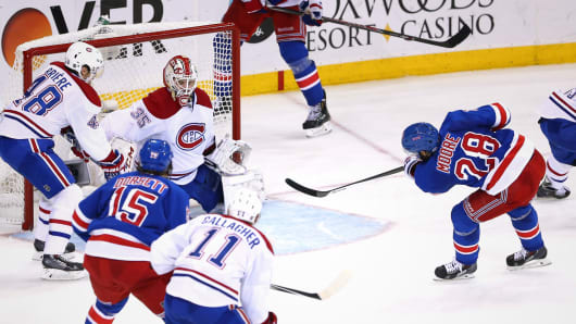 Dominic Moore No. 28 of the New York Rangers scores against Dustin Tokarski No. 35 of the Montreal Canadiens during Game Six of the Eastern Conference Final in the 2014 NHL Stanley Cup Playoffs at Madison Square Garden on May 29, 2014.