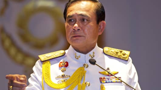 Thai army chief General Prayut Chan-O-Cha gestures during a press conference in Bangkok, May 26, 2014.