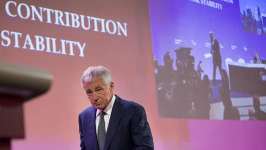 U.S. Defense Secretary Chuck Hagel walks to the podium to speak at the Asia Security Summit on May 31, 2014 in Singapore.