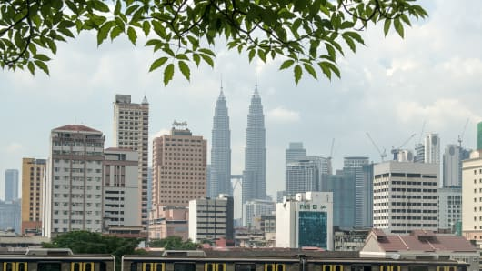 Malaysia's iconic Petronas Twin Towers in the background in downtown Kuala Lumpur.