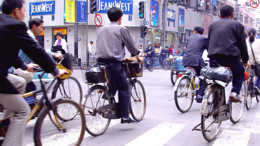 Cyclists in the city, Shanghai, China, Asia