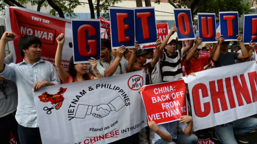 Vietnamese and Philippine protesters shout anti-China slogans in front of the Chinese consular office in Manila.
