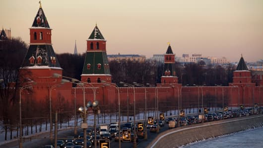 A traffic jam builds up along a road next to the Kremlin.