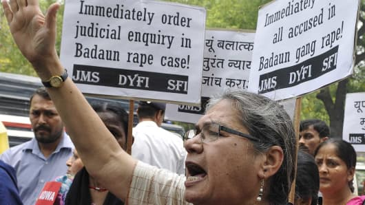 People from various organisations shout slogans against the Uttar Pradesh government during a protest march against the gang-rape of the two teenage cousins.