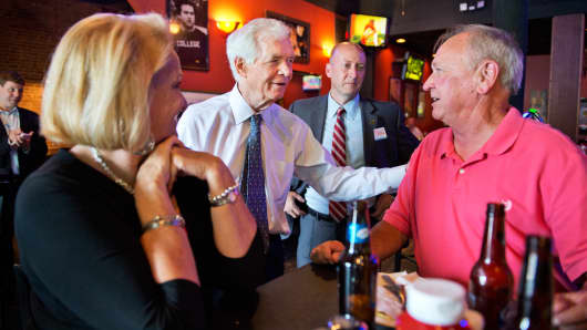 Sen. Thad Cochran, R-Miss., second from left, greets patrons at Windy City Grille as Mayor Chip Johnson looks on in Hernando, Miss., May 30, 2014.
