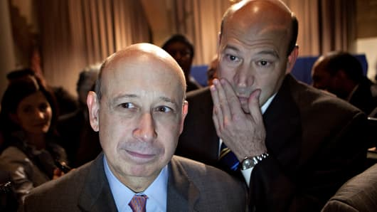 Lloyd C. Blankfein, chairman and CEO of Goldman Sachs Group, center, walks with Gary D. Cohn, Goldman's president and chief operating officer.