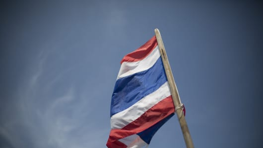 The flag of Thailand blows in the wind on Patong beach in Phuket, Thailand.