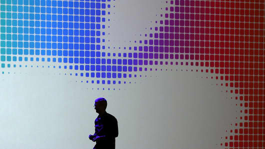 Apple CEO Tim Cook walks off stage after speaking during the Apple Worldwide Developers Conference at the Moscone West center on June 2, 2014 in San Francisco.