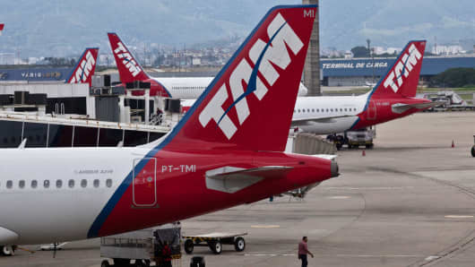 Latam Airlines Group SA's Tam airplanes on the tarmac at the Galeao airport in Rio de Janeiro, Brazil, Nov. 22, 2013.