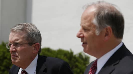 A day after winning a tight GOP senate primary in New Jersey, Jeff Bell, left, stands next to rival Richard Pezzullo during a news conference, June 4, 2014, in Freehold.