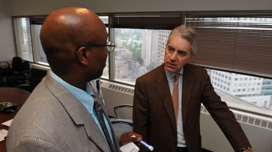 Kevin J. Counihan, right, chief executive officer of Access Health CT, meets with James Michel, left, the firm's operation manager in July 2013.
