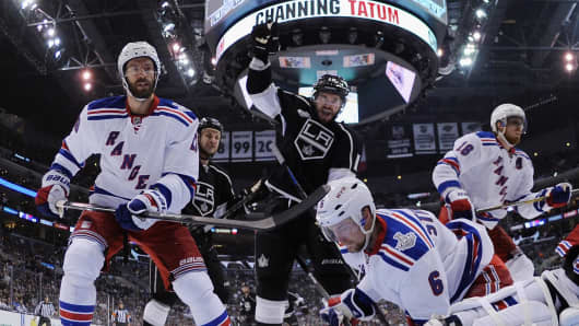 Mike Richards #10 of the Los Angeles Kings celebrates the game-winning goal by Justin Williams as the Kings defeated the Rangers 3-2 in Game One of the 2014 NHL Stanley Cup Final at the Staples Center on June 4, 2014 in Los Angeles, California.