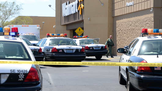 A Las Vegas Metropolitan Police Department officer walks outside a Wal-Mart on June 8, 2014 in Las Vegas, Nevada.