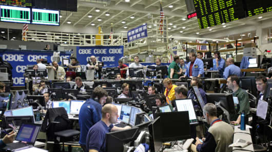 Traders work in the Volatility Index Options (VIX) pit on the floor of the Chicago Board Options Exchange (CBOE) in Chicago, Illinois, U.S.