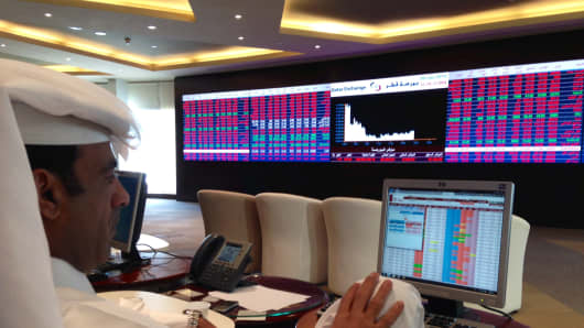 A trader at the Qatar Stock Exchange
