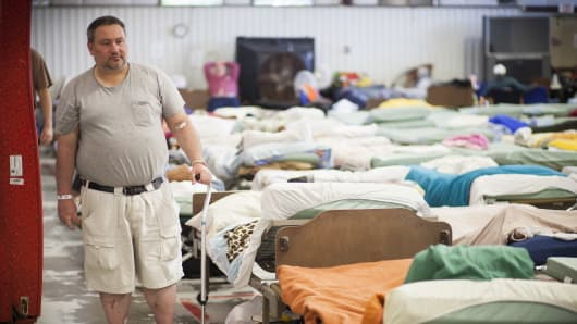 Ed Miller, who is recovering from congestive heart failure, at a homeless shelter where he lives in Texarkana, Texas, May 19, 2014. The poor living on the Arkansas side of Texarkana gained health coverage when the state accepted the Medicaid expansion in the Affordable Care Act, but the poor a few blocks across the border in Texas did not.