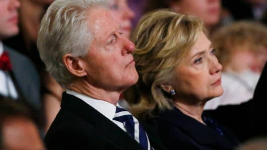 Former U.S. President Bill Clinton and former U.S. Secretary of State Hillary Clinton attend the opening ceremony for the National September 11 Memorial Museum, May 15, 2014 in New York City.