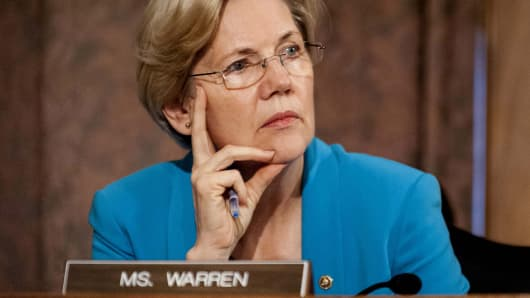 Sen. Elizabeth Warren, D-Mass., listens during a hearing on Capitol Hill, in Washington.