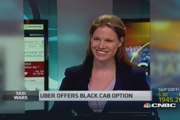 Uber to work with black cabs