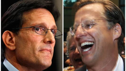 House Majority Leader Eric Cantor, R-Va., left, and Dave Brat, right, react after the polls close Tuesday, June 10, 2014, in Richmond, Va. Brat defeated Cantor in the Republican primary.