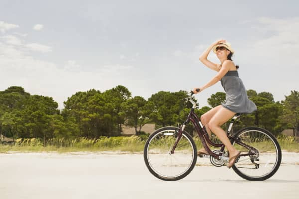 Woman riding her bike along beach in Hilton Head, South Carolina