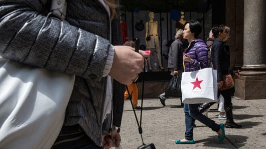 Shoppers walk through Herald Square, outside Macy's on 34th Street on May 1, 2014 in New York City.