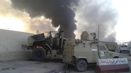 Damaged vehicles belonging to Iraqi security forces are seen during clashes between Iraqi security forces and al Qaeda-linked Islamic State in Iraq and the Levant (ISIL) in the northern Iraq city of Mosul, June 10, 2014.