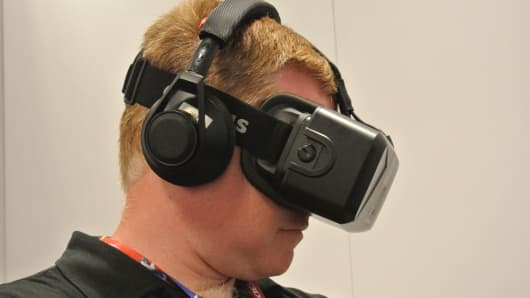 An attendee wears a 3-D Oculus headset at the 2014 E3 Electronic Entertainment Expo.